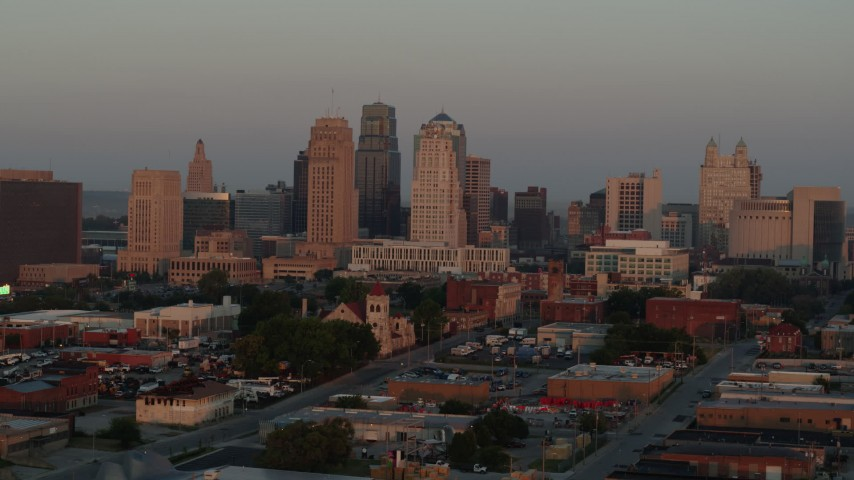 5.7K stock footage aerial video of a reverse view of the city skyline at sunrise, Downtown Kansas City, Missouri Aerial Stock Footage | DX0001_000998