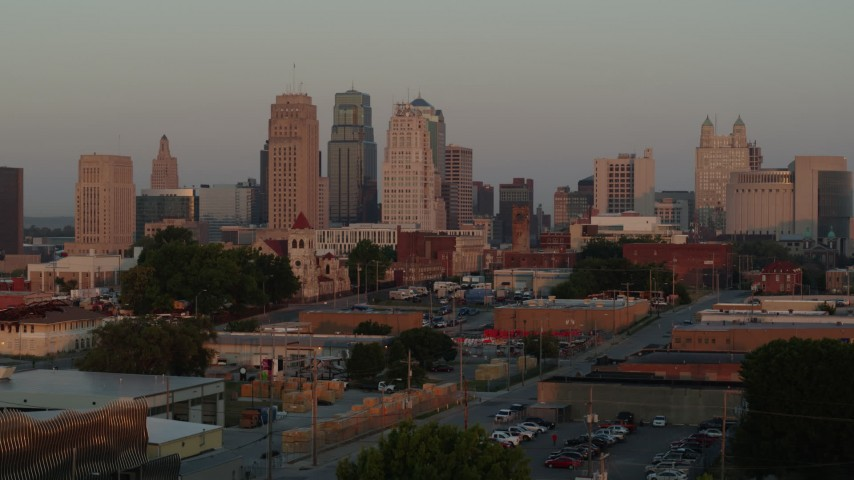 5.7K stock footage aerial video ascend to reveal the city skyline at sunrise, Downtown Kansas City, Missouri Aerial Stock Footage | DX0001_001001