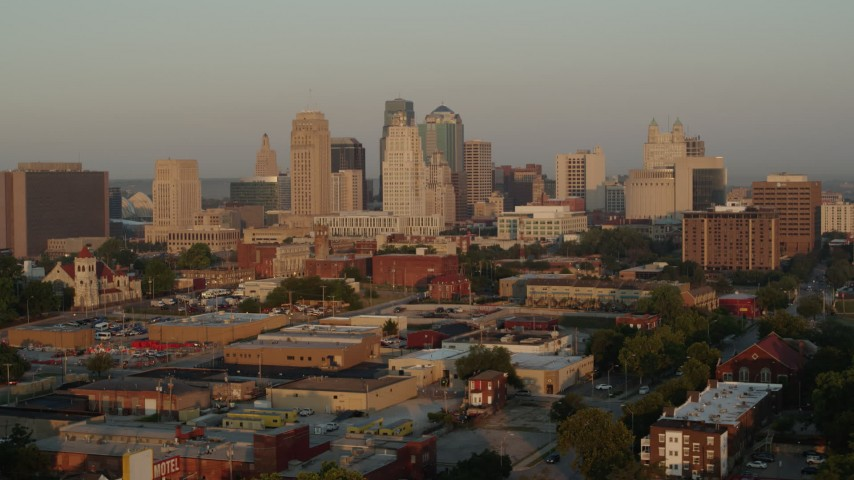 5.7K stock footage aerial video flyby the city skyline at sunrise, Downtown Kansas City, Missouri Aerial Stock Footage | DX0001_001004