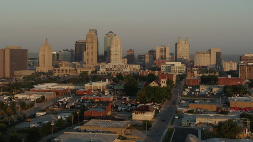 5.7K stock footage aerial video flyby the city skyline at sunrise, seen from an industrial area, Downtown Kansas City, Missouri Aerial Stock Footage | DX0001_001005