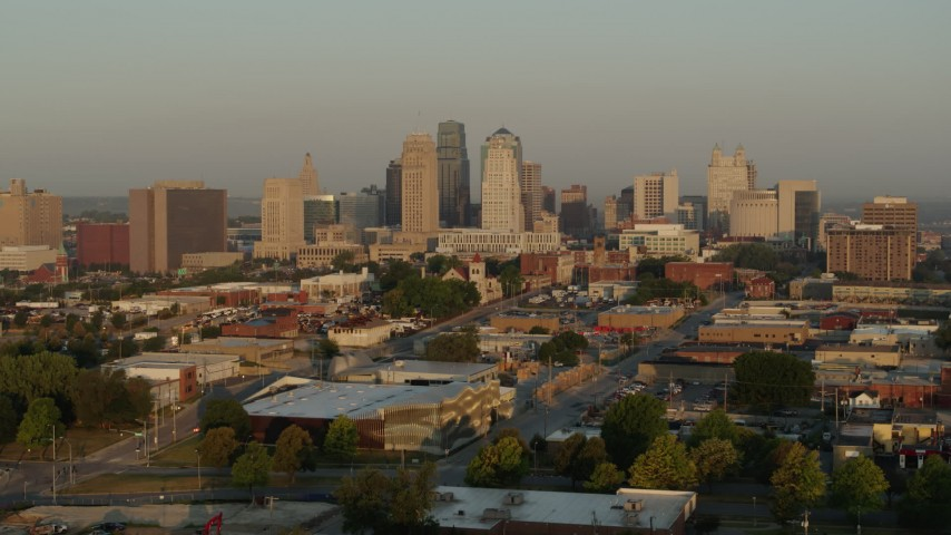 5.7K stock footage aerial video flyby and away from the city skyline at sunrise, seen from east of the city, Downtown Kansas City, Missouri Aerial Stock Footage | DX0001_001009
