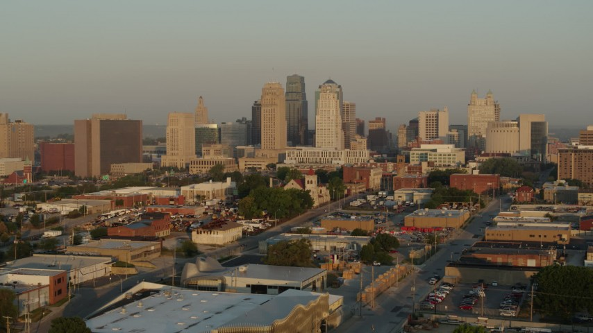 5.7K stock footage aerial video approach the city skyline at sunrise from east of the city, Downtown Kansas City, Missouri Aerial Stock Footage | DX0001_001010