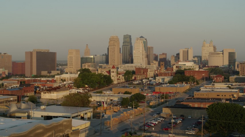 5.7K stock footage aerial video of a view of the city skyline at sunrise while descending, Downtown Kansas City, Missouri Aerial Stock Footage   DX0001_001013