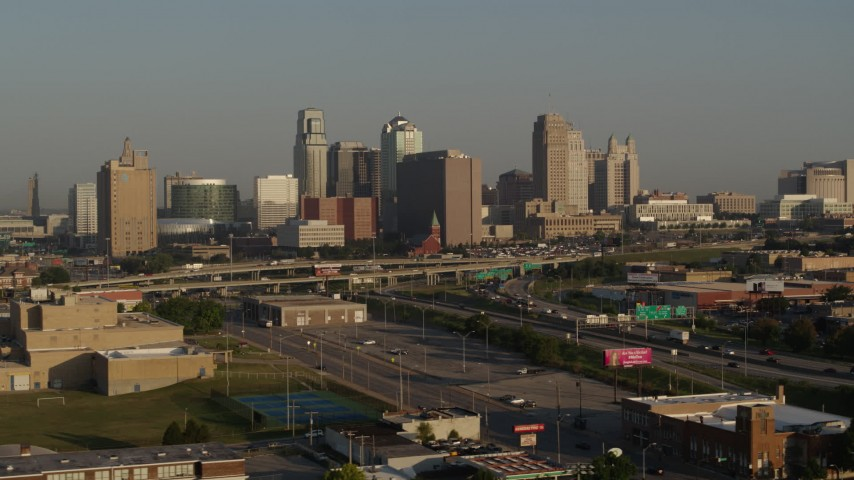 5.7K stock footage aerial video flyby the downtown skyline at sunrise, reveal freeway interchange, Downtown Kansas City, Missouri Aerial Stock Footage   DX0001_001016