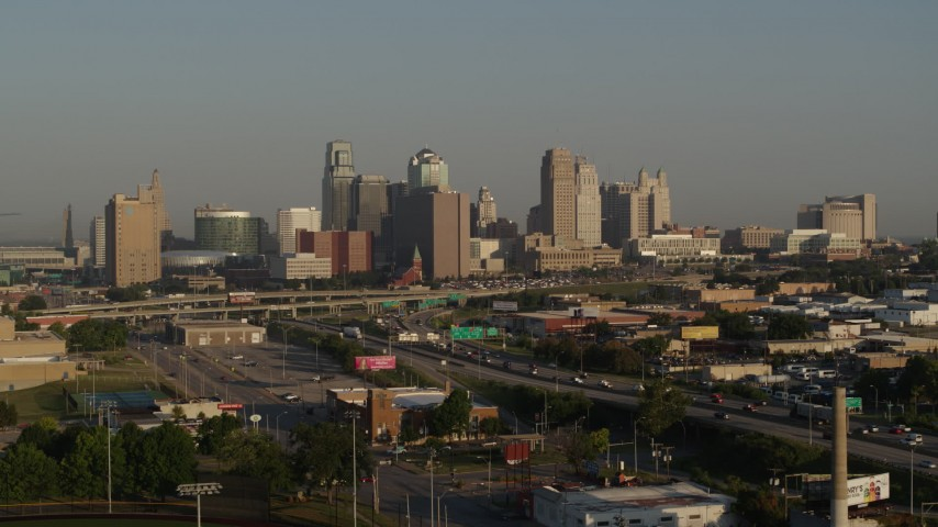 5.7K stock footage aerial video flyby the downtown skyline and freeway interchange at sunrise, Downtown Kansas City, Missouri Aerial Stock Footage | DX0001_001018