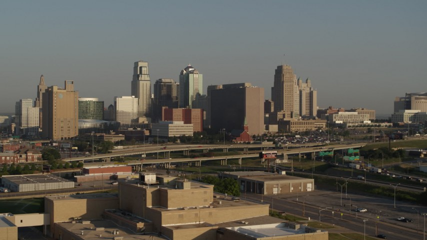 5.7K stock footage aerial video approach the downtown skyline and Hwy 71 at sunrise, Downtown Kansas City, Missouri Aerial Stock Footage | DX0001_001020