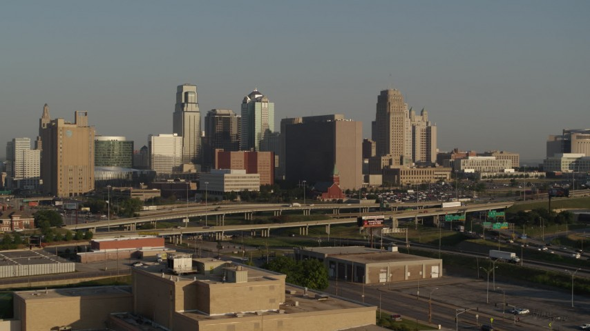 5.7K stock footage aerial video reverse view of the downtown skyline and Hwy 71 at sunrise, Downtown Kansas City, Missouri Aerial Stock Footage | DX0001_001021