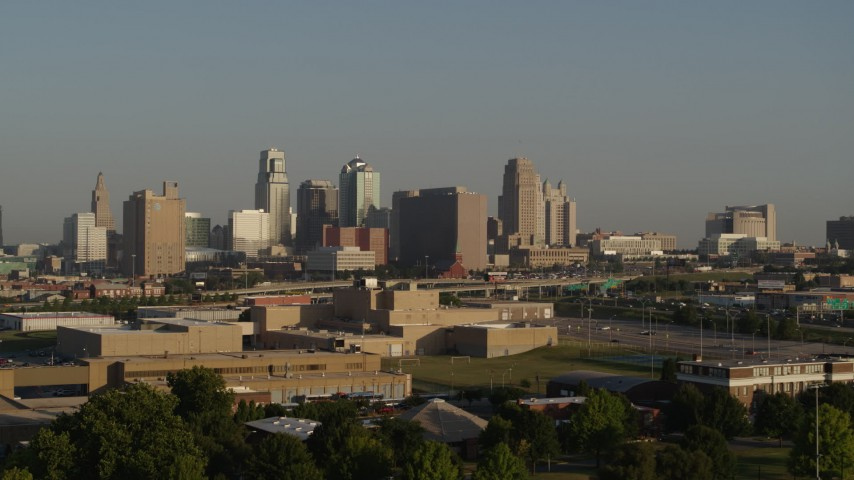 5.7K stock footage aerial video of a slow approach to the downtown skyline at sunrise, Downtown Kansas City, Missouri Aerial Stock Footage | DX0001_001023