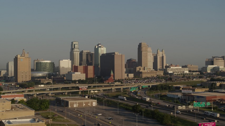 5.7K stock footage aerial video of a side view of the downtown skyline and freeway interchange at sunrise, Downtown Kansas City, Missouri Aerial Stock Footage | DX0001_001024