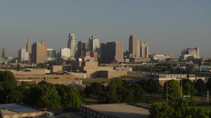 5.7K stock footage aerial video of the downtown skyline at sunrise, seen while descending near tech school in Downtown Kansas City, Missouri Aerial Stock Footage | DX0001_001027