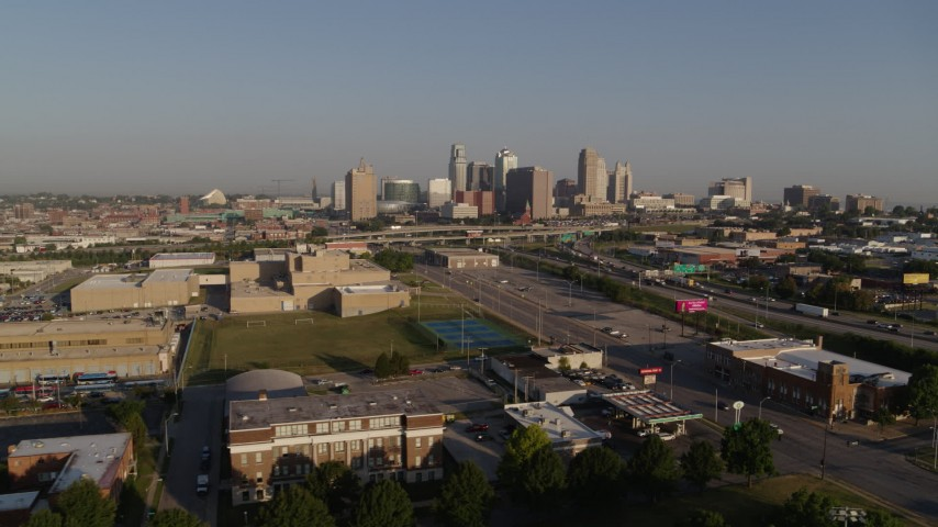 5.7K stock footage aerial video flyby and away from the city skyline, seen from south of I-70 in Downtown Kansas City, Missouri Aerial Stock Footage | DX0001_001031