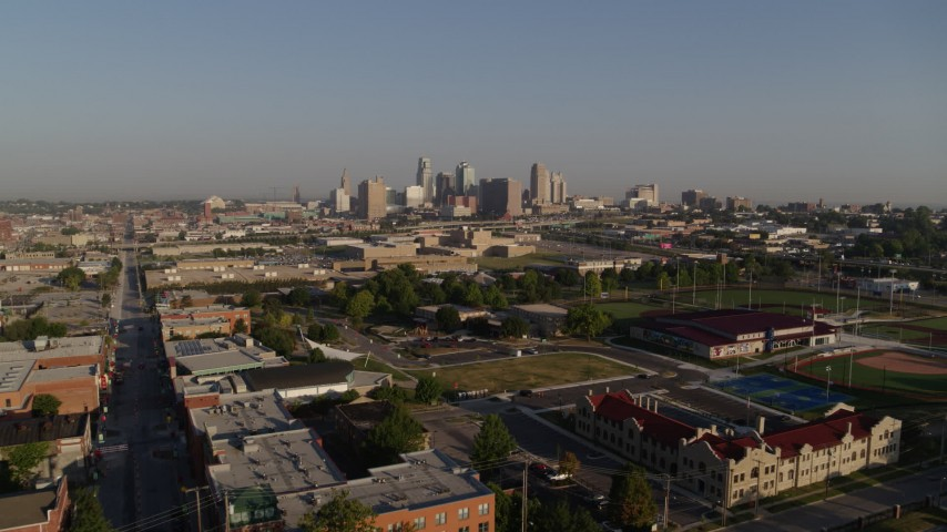 5.7K stock footage aerial video of a reverse view of the city skyline, reveal community center in Downtown Kansas City, Missouri Aerial Stock Footage   DX0001_001032