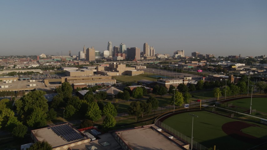 5.7K stock footage aerial video a view of the city skyline of Downtown Kansas City, Missouri while descending Aerial Stock Footage | DX0001_001036