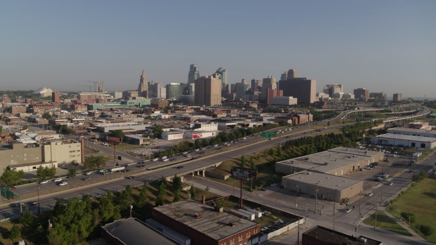 5.7K stock footage aerial video a view of the city skyline of Downtown Kansas City, Missouri from freeway Aerial Stock Footage | DX0001_001037