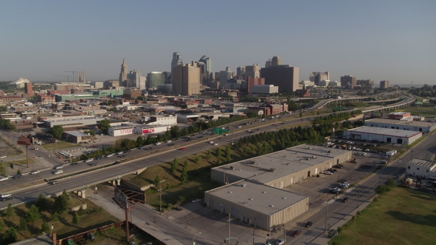 5.7K stock footage aerial video flyby a freeway east of city office buildings in Downtown Kansas City, Missouri Aerial Stock Footage | DX0001_001038