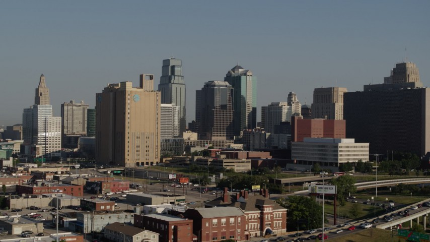 5.7K stock footage aerial video passing a city office building and skyscrapers in Downtown Kansas City, Missouri Aerial Stock Footage | DX0001_001051