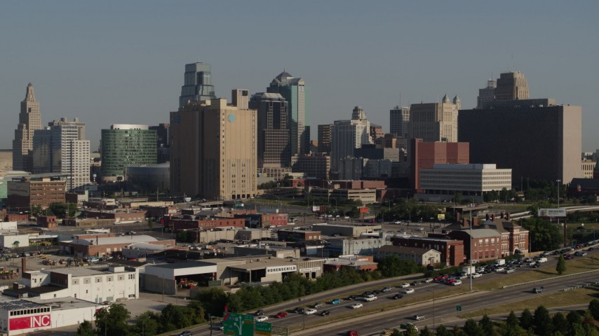 5.7K stock footage aerial video slowly flyby the city's skyline, seen from east of the freeway in Downtown Kansas City, Missouri Aerial Stock Footage | DX0001_001060