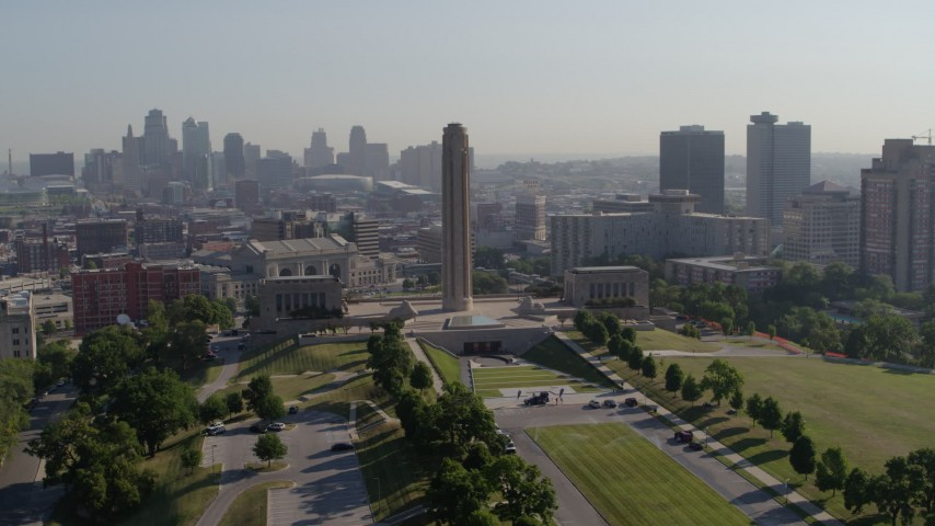 5.7K stock footage aerial video orbit the WWI memorial in Kansas City, Missouri, with a view of the downtown skyline Aerial Stock Footage | DX0001_001068