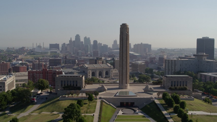5.7K stock footage aerial video ascend and fly toward the WWI memorial in Kansas City, Missouri, with a view of the downtown skyline Aerial Stock Footage | DX0001_001071