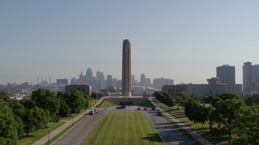 5.7K stock footage aerial video fly low and ascend toward the WWI memorial in Kansas City, Missouri, and the downtown skyline Aerial Stock Footage | DX0001_001073