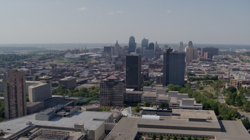 5.7K stock footage aerial video of the city skyline behind Crown Center office buildings, Downtown Kansas City, Missouri Aerial Stock Footage   DX0001_001085
