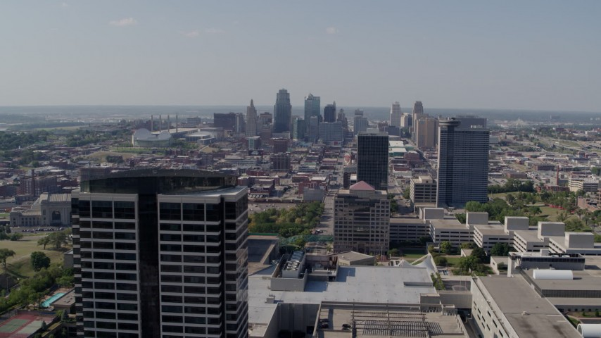 5.7K stock footage aerial video of the city skyline behind tall Crown Center office buildings, Downtown Kansas City, Missouri Aerial Stock Footage   DX0001_001086
