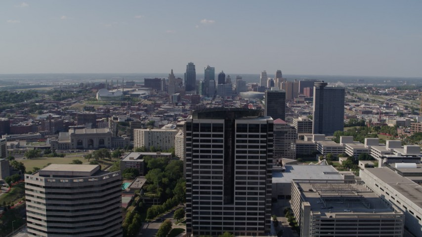 5.7K stock footage aerial video reverse view of city skyline behind Crown Center office building, Downtown Kansas City, Missouri Aerial Stock Footage | DX0001_001087
