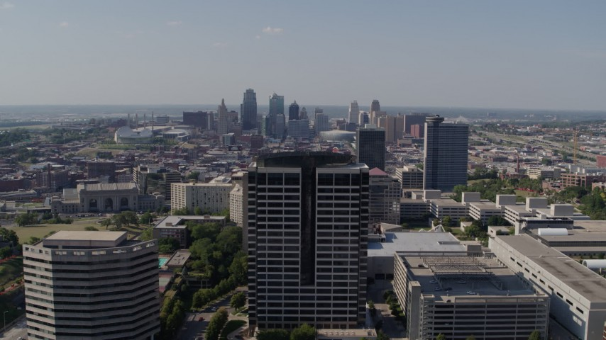 5.7K stock footage aerial video static view of city skyline behind Crown Center office building, Downtown Kansas City, Missouri Aerial Stock Footage | DX0001_001088