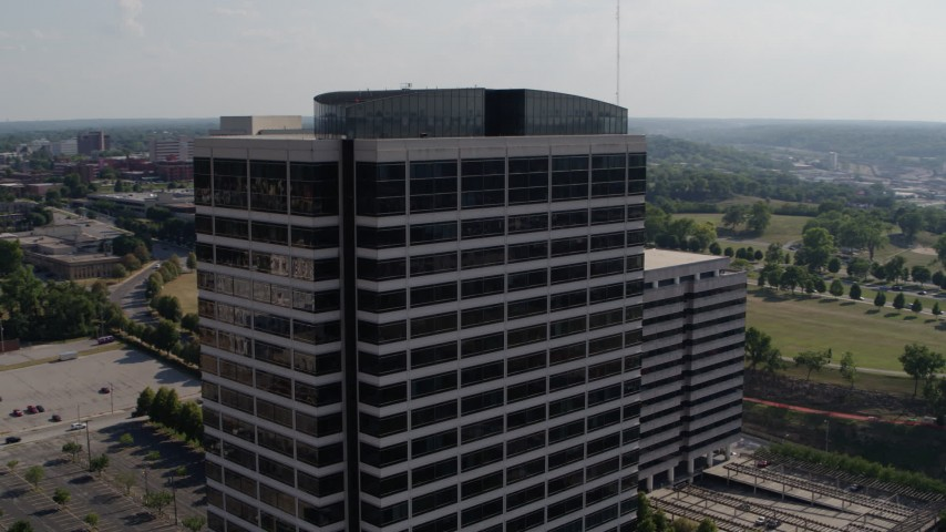 5.7K stock footage aerial video of orbiting the top of a Crown Center office building in Kansas City, Missouri Aerial Stock Footage | DX0001_001095