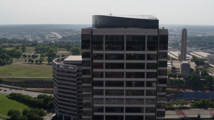 5.7K stock footage aerial video of circling the top of a Crown Center office building in Kansas City, Missouri Aerial Stock Footage | DX0001_001096
