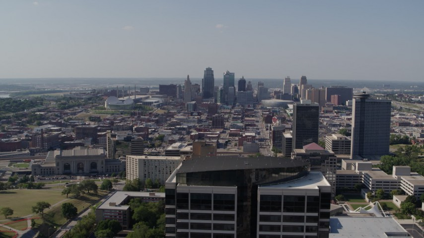 5.7K stock footage aerial video fly away from Downtown Kansas City, Missouri and reveal Crown Center office building Aerial Stock Footage | DX0001_001099
