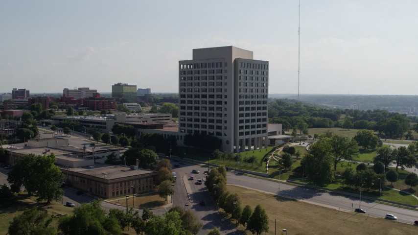 5.7K stock footage aerial video fly away from a government office building and descend, Kansas City, Missouri Aerial Stock Footage | DX0001_001101