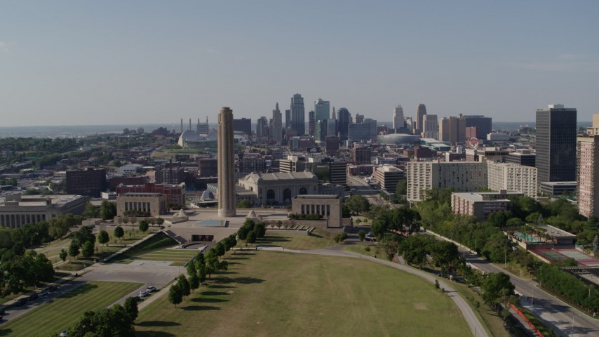 5.7K stock footage aerial video flyby WWI memorial for view of Downtown Kansas City, Missouri skyline Aerial Stock Footage | DX0001_001102