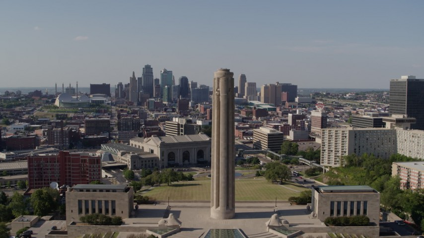 5.7K stock footage aerial video fly away from the WWI memorial and the Downtown Kansas City, Missouri skyline Aerial Stock Footage | DX0001_001109