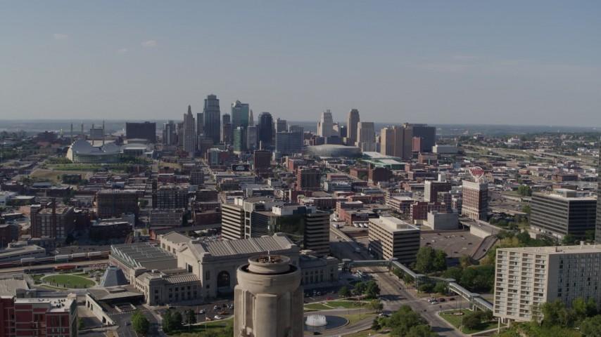 5.7K stock footage aerial video fly over the WWI memorial to approach the Downtown Kansas City, Missouri skyline Aerial Stock Footage   DX0001_001112