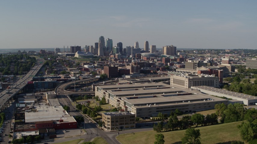 5.7K stock footage aerial video reverse view of a government office building and city skyline, Downtown Kansas City, Missouri Aerial Stock Footage | DX0001_001121