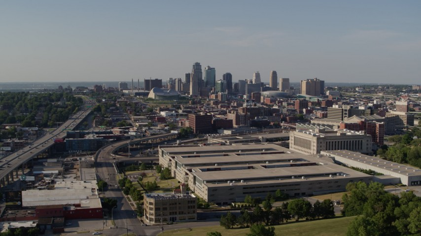 5.7K stock footage aerial video of flying away from a government building and city's skyline, Downtown Kansas City, Missouri Aerial Stock Footage | DX0001_001130