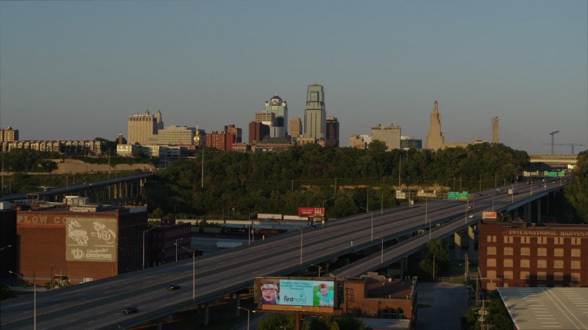 5.7K stock footage aerial video of the city's skyline seen from freeway at sunset in Downtown Kansas City, Missouri Aerial Stock Footage | DX0001_001161