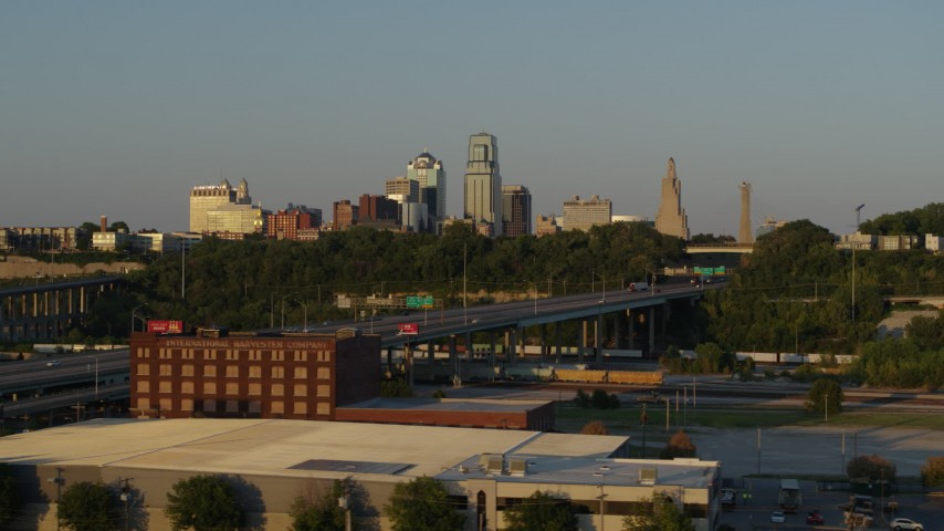 5.7K stock footage aerial video flyby freeway with light traffic with view of skyline at sunset in Downtown Kansas City, Missouri Aerial Stock Footage | DX0001_001165
