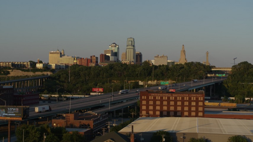 5.7K stock footage aerial video flying by freeway with light traffic with view of skyline at sunset in Downtown Kansas City, Missouri Aerial Stock Footage | DX0001_001166