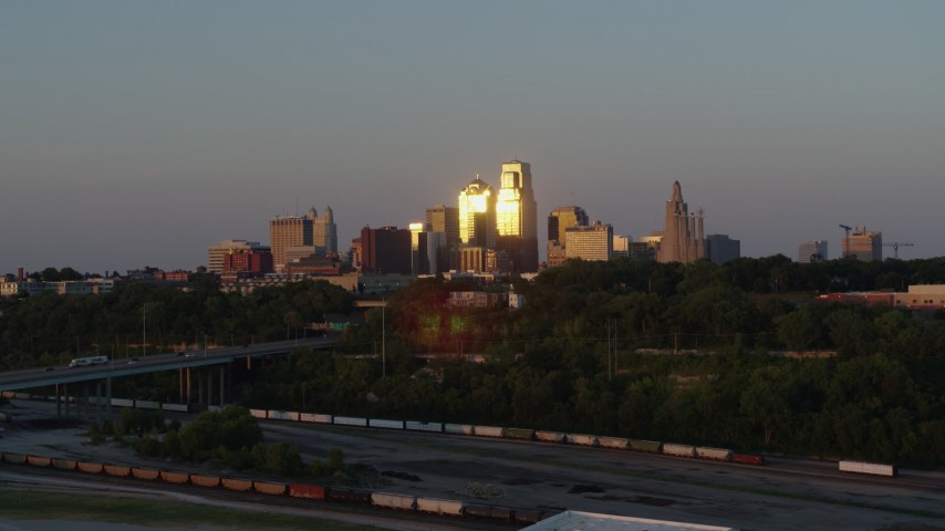 5.7K stock footage aerial video of the skyline at sunset seen from west of the city, Downtown Kansas City, Missouri Aerial Stock Footage | DX0001_001169