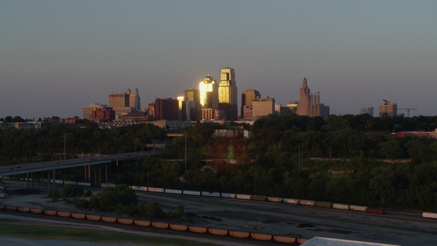 5.7K stock footage aerial video light from setting sun reflecting off skyscrapers in Downtown Kansas City, Missouri Aerial Stock Footage | DX0001_001170