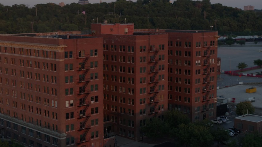 5.7K stock footage aerial video of orbiting a brick office building at twilight in Kansas City, Missouri Aerial Stock Footage | DX0001_001172