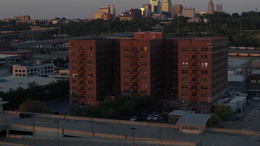 5.7K stock footage aerial video orbit around a brick office building at twilight in Kansas City, Missouri Aerial Stock Footage | DX0001_001173