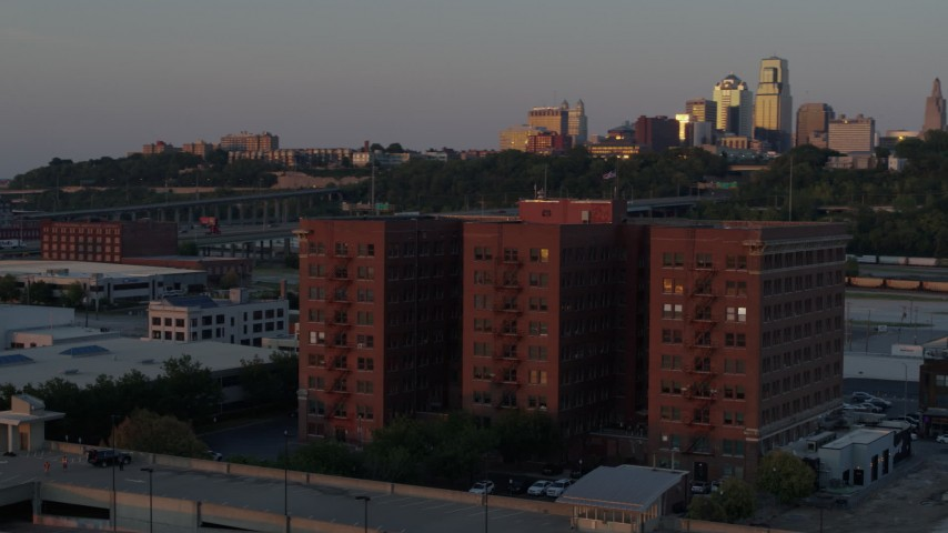 5.7K stock footage aerial video circle around a brick office building at twilight in Kansas City, Missouri Aerial Stock Footage | DX0001_001174