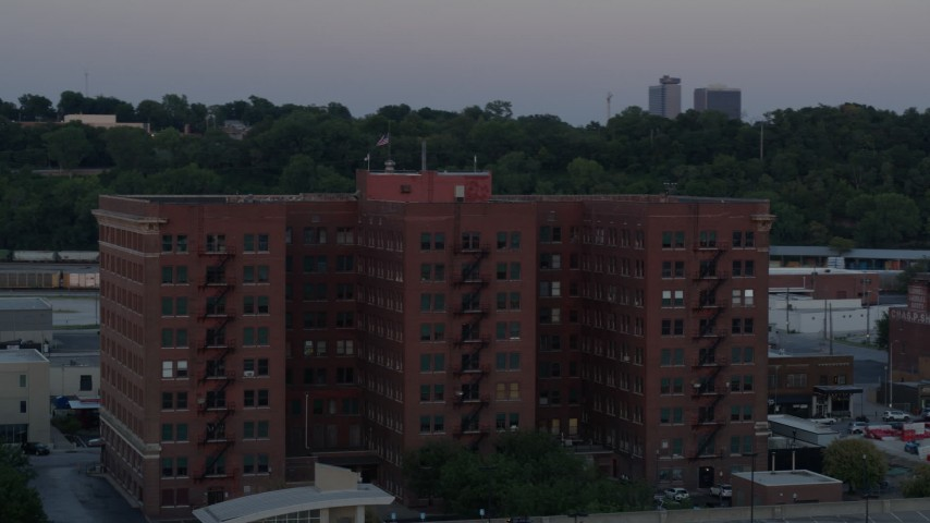 5.7K stock footage aerial video orbit front of brick office building at twilight, Kansas City, Missouri Aerial Stock Footage | DX0001_001185