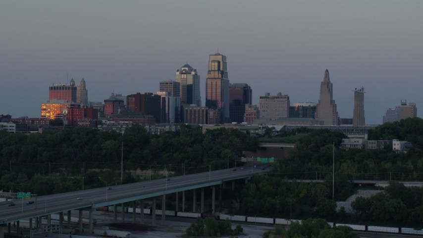 5.7K stock footage aerial video flyby city skyline at twilight, seen from I-670, Downtown Kansas City, Missouri Aerial Stock Footage | DX0001_001188