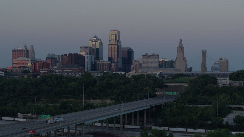 5.7K stock footage aerial video static view and flyby of city skyline at twilight, seen from I-670, Downtown Kansas City, Missouri Aerial Stock Footage | DX0001_001189