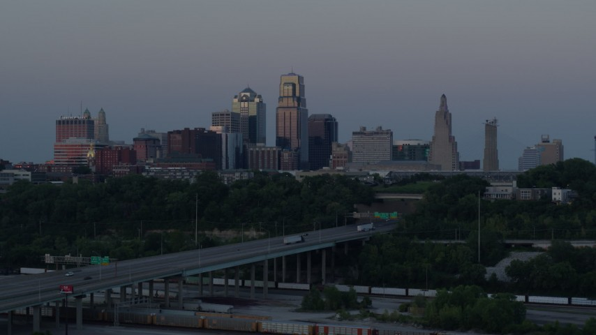 5.7K stock footage aerial video of the I-670 freeway and city skyline at twilight in Downtown Kansas City, Missouri Aerial Stock Footage | DX0001_001192