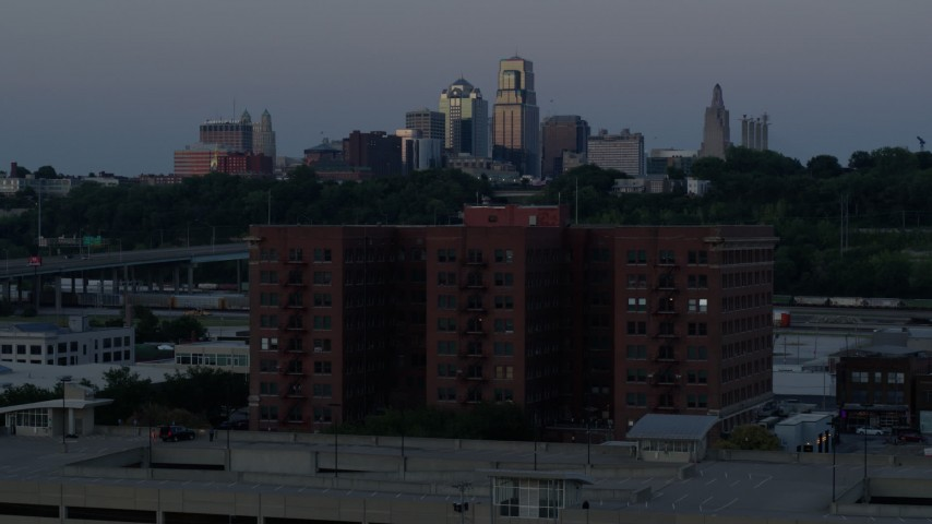 5.7K stock footage aerial video reverse and static view of brick building and skyline at twilight, Downtown Kansas City, Missouri Aerial Stock Footage | DX0001_001200